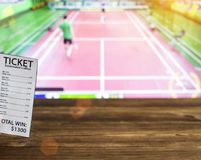 Bookmaker ticket on the background of TV on which goes badminton, betting office, sports betting. Shuttlecock royalty free stock photography