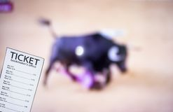 Bookmaker ticket on the background of TV on which show bullfight, sports betting, bookmaker. Bookmaker ticket on the background of TV on which show bullfight stock photography