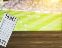 Bookmaker ticket on the background of TV on which show Gaelic football, sports betting, bookmaker. Bookmaker ticket on the background of TV on which show Gaelic stock image