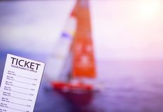 Bookmaker ticket on the background of the TV on which show sailing, sports betting, yachting sport, bookmaker ticket. Bookmaker ticket on the background of the royalty free stock photography