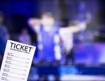 Bookmaker ticket on the background of TV on which show sports archery, sports betting, bookmaker, archery. Bookmaker ticket on the background of TV on which show stock photography