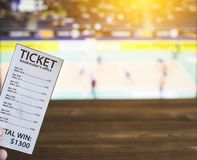 Bookmaker ticket on the background of a TV on which show volleyball, sports betting, volleyball. Bookmaker ticket on the background of a TV on which show royalty free stock photo