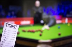 Bookmaker ticket on the background of the TV, which shows a game of snooker, sports betting, bookmaker ticket. Bookmaker ticket on the background of the TV royalty free stock photography