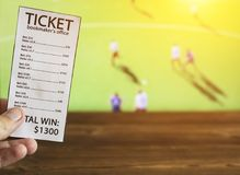 Bookmaker ticket on the background of the TV, which shows hockey on the grass, sports betting, bookmaker ticket, lawn hockey. Bookmaker ticket on the background royalty free stock images