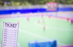 Bookmaker ticket on the background of the TV, which shows hockey on the grass, sports betting, bookmaker ticket, lawn hockey. Bookmaker ticket on the background stock photos