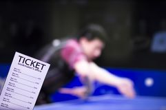 Bookmaker ticket on the background of the TV, which shows table tennis, sports betting, bookmaker ticket, ping-pong. Bookmaker ticket on the background of the TV royalty free stock images