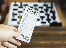 Bookmaker ticket on the background of the TV on which the sport is shown playing chess, checkers, sports betting, chess, bookmaker royalty free stock image