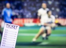 Bookmaker ticket on the background of the TV on which there is a sports game of cricket, sports betting, gambler. Bookmaker ticket on the background of the TV on royalty free stock image