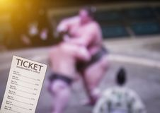 Bookmaker ticket on TV background on which show sumo sport, sports betting, bookmaker, sumo. Bookmaker ticket on TV background on which show sumo sport, sports royalty free stock photos