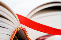 Bookmark. A bookmark in a book helps to find the correct page. Macro with extremely shallow depth of field Stock Image
