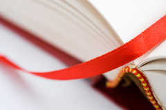 Bookmark. A bookmark in a book helps to find the correct page. Macro with extremely shallow depth of field Stock Photo