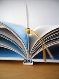 Bookmark. An open book with bookmark royalty free stock photo