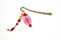 Bookmark in the book. With beads Royalty Free Stock Photo