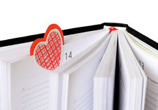 Bookmark in a diary. Heart shaped bookmark at Valentine's Day Stock Images