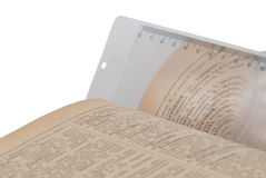 Bookmark magnifier. In book isolated on white Stock Photo