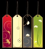Bookmark tags. Four bookmark tags with strings isolated on a black background Royalty Free Stock Photography
