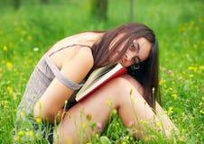 Bookreader. Young woman reading a book outdoors Royalty Free Stock Photos