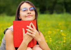 Bookreader. Young woman reading a book outdoors Royalty Free Stock Image
