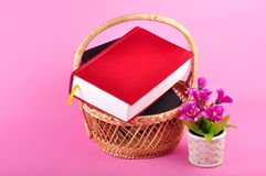 Books. Stacked books on bamboo basket Stock Image