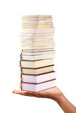 Books. Human hands carrying books against white Stock Photos