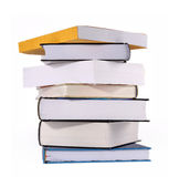 Books. View from the bottom, a stack of books that  need to be organized, against white background Royalty Free Stock Photo