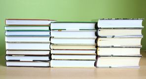 Books. Some books with green background stock photography