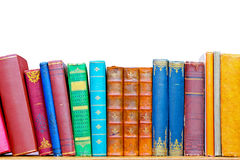 Books. Used grunge colourful books at library shelf Royalty Free Stock Images