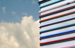 Books. A stack of books with the sky as background Stock Image