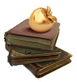 Books. Three old books on white background with a golden apple Royalty Free Stock Photography