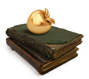 Books. Two old books on white background with a golden apple Royalty Free Stock Image