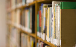 Books Literature on Long Shelf Row IN Labrary stock images