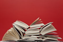 Books. A group of books on red background Royalty Free Stock Photo