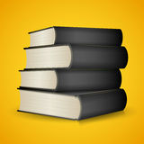 Books. Stack of books isolated on yellow background Royalty Free Stock Photo