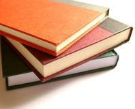 Books. Three hard cover books in a pile Royalty Free Stock Images