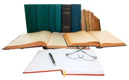 Books. Old books with pen, notebook and eyeglasses isolated on a white background Stock Image