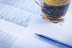 Books. Dictionary and pen on light background royalty free stock images