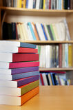 Books. On a table in library Stock Images