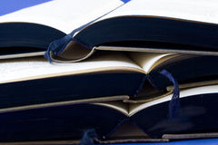 Books. Old book collection with the front of its pages tinted of blue Stock Image