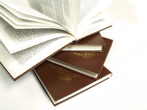 Books. Stack of four brown books royalty free stock image