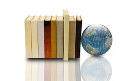 Books and 3d earth globe. Stack of books and 3d earth globe on white background Royalty Free Stock Image