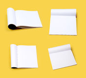 Books. On yellow background with clipping path Stock Photos