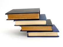 Books. Steps formed with four old books on white background stock photos