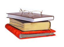 Books. Open books and glasses isolated on white royalty free stock photo