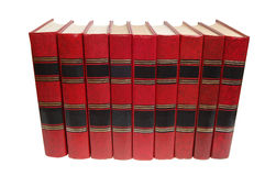 Books. Red books in a row, isolated on white Stock Images