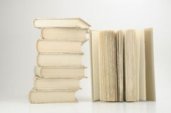 Books. Stock of books on white background, one book open on right side Royalty Free Stock Photography