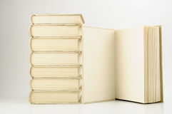 Books. Stock of books on white background, one book open on right side royalty free stock image