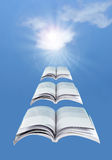 Books. Flying open books over a blue sky Stock Photo