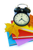 Books and alarm clock Royalty Free Stock Photos