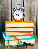 Books and an alarm clock. Stock Photography