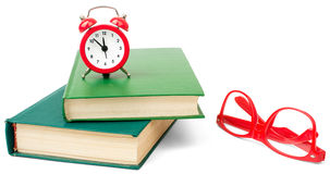 Books with alarm clock Stock Image